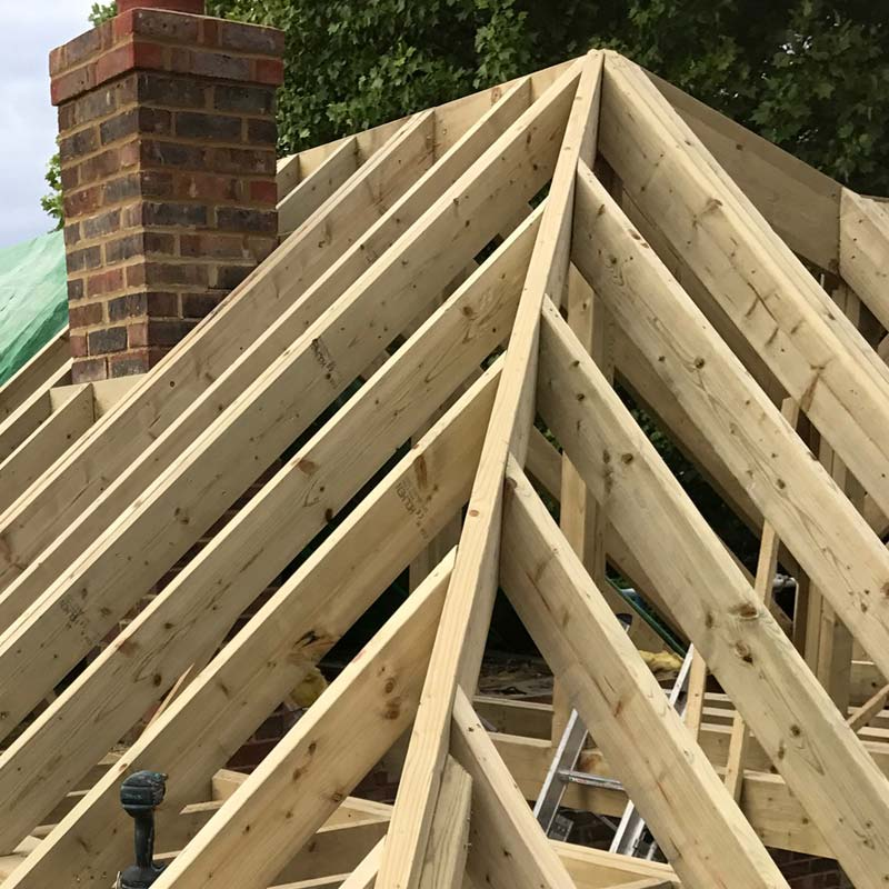 Extension roof slope construction